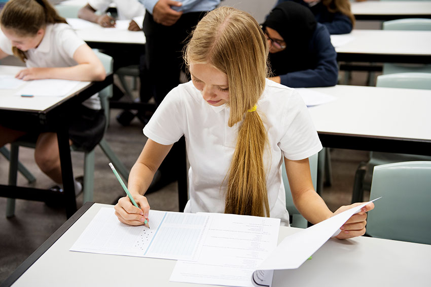 students-doing-the-exam-in-classroom-PXVKR9W